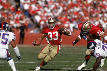 SAN FRANCISCO - JANUARY 20:  Running back Roger Craig #33 of the San Francisco 49ers looks for room to run during the 1990 NFC Championship game against the New York Giants at Candlestick Park on January 20, 1991 in San Francisco, California.  The Giants