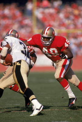 SAN FRANCISCO - DECEMBER 11:  Defensive back Jeff Fuller #49 of the San Francisco 49ers goes after the New Orleans Saints ball carrier during a game at Candlestick Park on December 11, 1988 in San Francisco, California.  The 49ers won 30-17.  (Photo by Ge