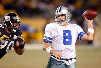 PITTSBURGH - DECEMBER 7:  Quarterback Tony Romo #9 of the Dallas Cowboys looks to pass the ball with his left hand while under pressure from Travis Kirschke #90 of the Pittsburgh Steelers during their NFL game on December 7, 2008 at Heinz Field in Pittsbu