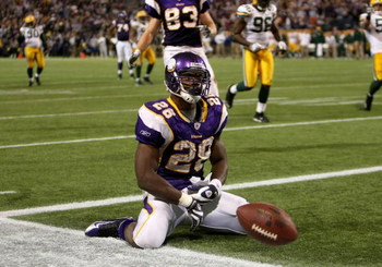 MINNEAPOLIS - NOVEMBER 09:  Running back Adrian Peterson #28 of the Minnesota Vikings celebrates his game winning 29 yard touchdown run with 2:22 left in the game with the Green Bay Packers on November 9, 2008 at the Metrodome in Mineapolis, Minnesota.  (