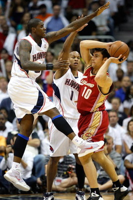 ATLANTA - MAY 11:  Marvin Williams and Maurice Evans #1 of the Atlanta Hawks defend against Wally Szczerbiak #10 of the Cleveland Cavaliers during Game Four of the Eastern Conference Semifinals during the 2009 NBA Playoffs at Philips Arena on May 11, 2009