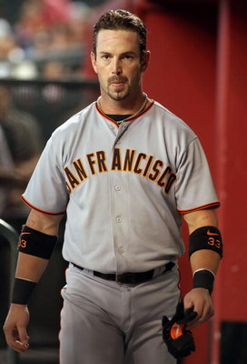 PHOENIX - JUNE 11:  Aaron Rowand #33 the San Francisco Giants walks in the dugout during the major league baseball game against the Arizona Diamondbacks at Chase Field on June 11, 2009 in Phoenix, Arizona.  The Diamondbacks defeated the Giants 2-1.  (Phot