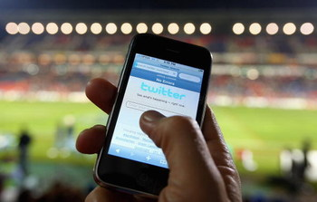 NEWCASTLE, AUSTRALIA - JULY 11:  In this photo illustration the Twitter website is displayed on a mobile phone at a NRL match on July 11, 2009 in Newcastle, Australia. The micro-blogging phenomenon sees users post text 'tweets' of upto 140 characters in r