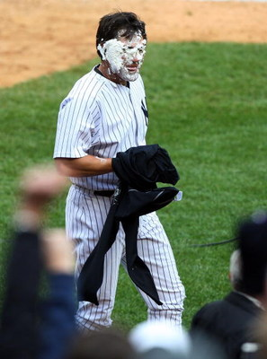 NEW YORK - MAY 17:  Johnny Damon #18 of the New York Yankees looks on after getting a shaving cream pie in his face after his walk off home run against the Minnesota Twins on May 17, 2009 at Yankee Stadium in the Bronx borough of New York City. The Yankee