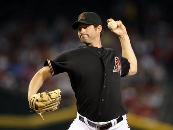 PHOENIX - MAY 30:  Starting pitcher Doug Davis #49 of the Arizona Diamondbacks pitches against the Atlanta Braves during the major league baseball game at Chase Field on May 30, 2009 in Phoenix, Arizona. The Diamondbacks defeated the Braves 3-2.  (Photo b