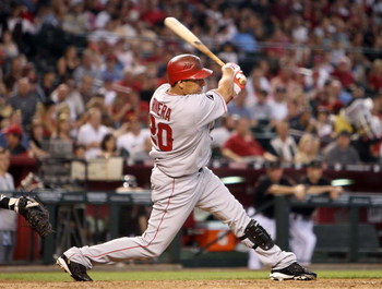 PHOENIX - JUNE 27:  Juan Rivera #20 of the Los Angeles Angels of Anaheim hits a single against the Arizona Diamondbacks during the major league baseball game at Chase Field on June 27, 2009 in Phoenix, Arizona. The Angels defeated the Diamondbacks 2-1.  (