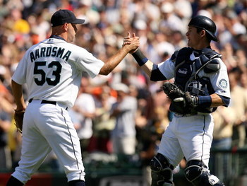 SEATTLE  - MAY 24:  Pitcher David Aardsma #53 of the Seattle Mariners celebrates with catcher Rob Johnson #32 after defeating  the San Francisco Giants 5-4 on May 24, 2009 at Safeco Field in Seattle, Washington. (Photo by Otto Greule Jr/Getty Images)