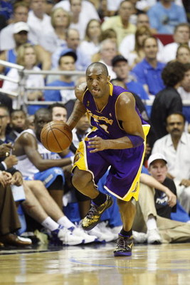 ORLANDO, FL - JUNE 14:  Kobe Bryant #24 of the Los Angeles Lakers moves the ball against the Orlando Magic in Game Five of the 2009 NBA Finals on June 14, 2009 at Amway Arena in Orlando, Florida. The Lakers won 99-86.  NOTE TO USER:  User expressly acknow