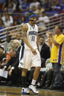 ORLANDO, FL - JUNE 14:  Courtney Lee #11 of the Orlando Magic walks down the court during Game Five of the 2009 NBA Finals against the Los Angeles Lakers on June 14, 2009 at Amway Arena in Orlando, Florida. The Lakers won 99-86. NOTE TO USER:  User expres