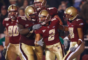 CHESTNUT HILL, MA - NOVEMBER 8: Brandon Robinson #2 of the Boston College Eagles scores a touchdown and celebrates with teammates against the Notre Dame Fighting Irish on November 8, 2008 at Alumni Stadium in Chestnut Hill, Massachusetts.  (Photo by Jim R