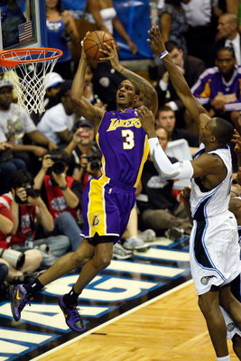 ORLANDO, FL - JUNE 11:  Trevor Ariza #3 of the Los Angeles Lakers goes up for a shot against Dwight Howard #12 of the Orlando Magic in the second quarter of Game Four of the 2009 NBA Finals on June 11, 2009 at Amway Arena in Orlando, Florida.  NOTE TO USE