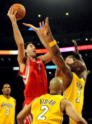 LOS ANGELES, CA - MAY 06:  Luis Scola #4 of the Houston Rockets shoots the ball over Derek Fisher #2, Lamar Odom #7 and Pau Gasol #16 of the Los Angeles Lakers in the third quarter of Game Two of the Western Conference Semifinals during the 2009 NBA Playo