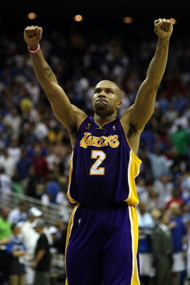 ORLANDO, FL - JUNE 11:  Derek Fisher #2 of the Los Angeles Lakers reacts after defeating the Orlando Magic 99-91 in overtime of Game Four of the 2009 NBA Finals on June 11, 2009 at Amway Arena in Orlando, Florida.  NOTE TO USER:  User expressly acknowledg