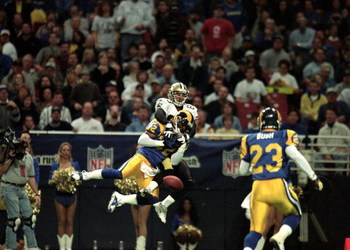 28 Nov 1999: Dre Bly #32 of the St. Louis Rams fumbles the ball as he is tackled by Keith Poole #83 of the New Orleans Saints  at the Trans World Dome in St. Louis, Missouri. The Rams defeated the Saints 43-12. Mandatory Credit: Elsa Hasch  /Allsport