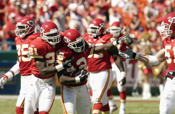 KANSAS CITY, MO - SEPTEMBER 7:  Safety Shaunard Harts #42 of the Kansas City Chiefs celebrates his interception against the San Diego Chargers with teammates Dexter McCleon #21 and Scott Fujita #51 on September 7, 2003 at Arrowhead Stadium in Kansas City,