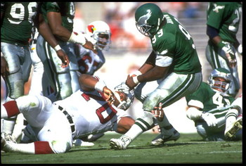 24 NOV 1991:  PHILADELPHIA EAGLES DEFENSIVE LINMAN DEREK BROWN (RIGHT) PULLS PHOENIX CARDINALS OFFENSIVE LINEMAN DENNIS KENNARD BY THE FACEMASK DURING THE EAGLES 34-14 WIN AT SUN DEVIL STADIUM IN TEMPE, ARIZONA.  MANDATORY CREDIT:  MIKE POWELL/ALLSPORT