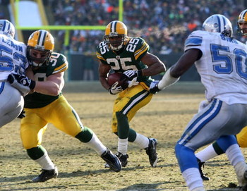 GREEN BAY, WI - DECEMBER 28: Ryan Grant #25 of the Green Bay Packers looks for running room against the Detroit Lions on December 28, 2008 at Lambeau Field in Green Bay, Wisconsin. The Packers defeated the Lions 31-21. (Photo by Jonathan Daniel/Getty Imag