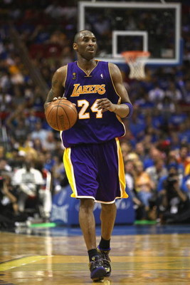 ORLANDO, FL - JUNE 14:  Kobe Bryant #24 of the Los Angeles Lakers moves the ball against the Orlando Magic in Game Five of the 2009 NBA Finals on June 14, 2009 at Amway Arena in Orlando, Florida. The Lakers won 99-86. NOTE TO USER:  User expressly acknowl
