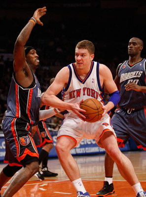 NEW YORK - MARCH 07:  David Lee #42 of the New York Knicks drives to the basket against the Charlotte Bobcats on March 7, 2009 at Madison Square Garden in New York City. NOTE TO USER: User expressly acknowledges and agrees that, by downloading and or usin