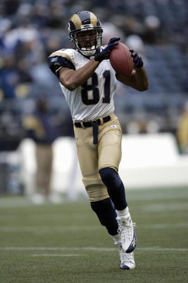 SEATTLE - NOVEMBER 13:  Torry Holt #81 of the St. Louis Rams makes a catch during the game with the Seattle Seahawks at Qwest Field on November 13, 2005 in Seattle, Washington.  The Seahawks won 31-16. (Photo by Otto Greule Jr/Getty Images)