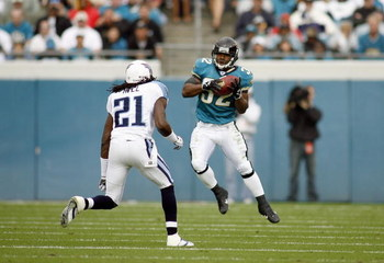 JACKSONVILLE, FL - NOVEMBER 05: Maurice Jones -Drew #32 of the Jacksonville Jaguars makes a catch during the game against Reynaldo Hill #21 of the Tennessee Titans on November 5, 2006 at Alltel Stadium in Jacksonville, Florida. (Photo by Marc Serota/Getty