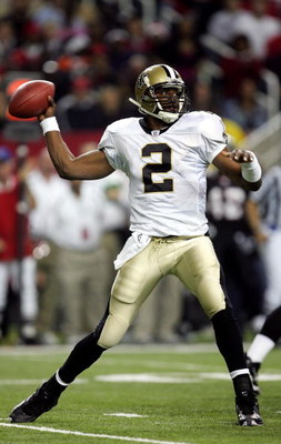 ATLANTA - DECEMBER 12:  Aaron Brooks #2 of the New Orleans Saints looks to pass against the Atlanta Falcons in NFL action December 12, 2005 at the Georgia Dome in Atlanta, Georgia.  (Photo By Streeter Lecka/Getty Images)