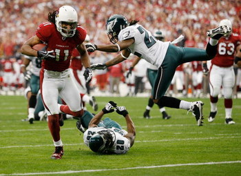 GLENDALE, AZ - JANUARY 18:  Larry Fitzgerald #11 of the Arizona Cardinals runs past safety Brian Dawkins #20 and cornerback Asante Samuel #22 of the Philadelphia Eagles into the endzone for a touchdown during the NFC championship game on January 18, 2009