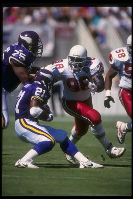 3 Oct 1994: Defensive lineman Eric Swann of the Arizona Cardinals works against the Minnesota Vikings during a game at Sun Devil Stadium in Tempe, Arizona. The Cardinals won the game, 17-7.