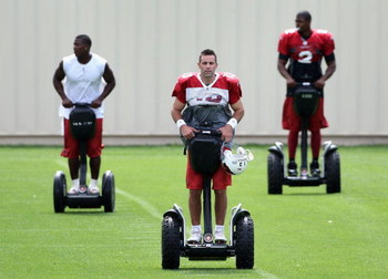 FLAGSTAFF, AZ - JULY 31: Quarterback Kurt Warner #13 of the Arizona Cardinals rides a segway across the field with teammates before the evening team training camp at Northern Arizona University on July 31, 2009 in Flagstaff, Arizona. (Photo by Christian P