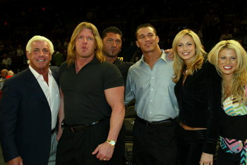 NEW YORK - MARCH 9:  WWE wrestlers (L-R) Ric Flair, Triple H, Batista, Randy Orton, Stacy Kiebler & Miss Jackie attend the New York Knicks v Boston Celtics  NBA game March 9, 2004 at Madison Square Garden in New York City.   (Photo by Ray Amati/Getty Imag