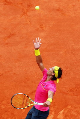 PARIS - MAY 31:  Rafael Nadal of Spain serves during the Men's Singles Fourth Round match against Robin Soderling of Sweden on day eight of the French Open at Roland Garros on May 31, 2009 in Paris, France.  (Photo by Ryan Pierse/Getty Images)