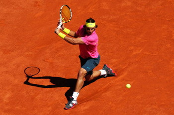 PARIS - MAY 29:  Rafael Nadal of Spain hits a backhand during his Men's Singles Third Round match against Lleyton Hewitt of Australia on day six of the French Open at Roland Garros on May 29, 2009 in Paris, France.  (Photo by Ryan Pierse/Getty Images)