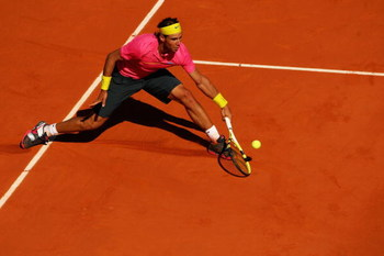 PARIS - MAY 29:  Rafael Nadal of Spain stretches for a backhand during his Men's Singles Third Round match against Lleyton Hewitt of Australia on day six of the French Open at Roland Garros on May 29, 2009 in Paris, France.  (Photo by Clive Brunskill/Gett