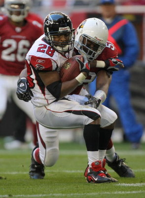GLENDALE, AZ - DECEMBER 23:  Warrick Dunn #28 of the Atlanta Falcons is tackled by Karlos Dansby #58 of the Arizona Cardinals during the second quarter at University of Phoenix Stadium on December 23, 2007 in Glendale, Arizona.  The Cardinals won 30-27 in