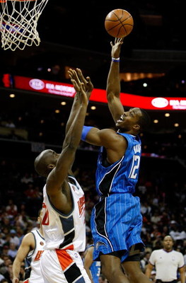 CHARLOTTE, NC - FEBRUARY 20:  Dwight Howard #12 of the Orlando Magic shoots the ball over Emeka Okafor #50 of the Charlotte Bobcats during their game at Time Warner Cable Arena on February 20, 2009 in Charlotte, North Carolina. NOTE TO USER: User expressl
