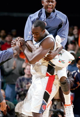 CHARLOTTE, NC - DECEMBER 14:   Theron Smith #0 jumps on teammate Emeka Okafor #50 of the Charlotte Bobcats after Okafor hit two free throws to win the game 94-93 against the New Orleans Hornets on December 14, 2004 at the Charlotte Coliseum in Charlotte,