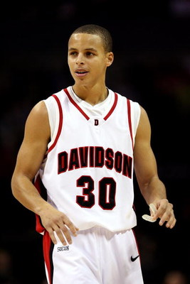CHARLOTTE, NC - DECEMBER 06:  Stephen Curry #30 of the Davidson Wildcats watches on during their game against the North Carolina State Wolfpack at Time Warner Cable Arena on December 6, 2008 in Charlotte, North Carolina.  (Photo by Streeter Lecka/Getty Im