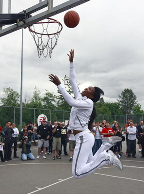 BURNABY, CANADA - JULY 13: In this photo provided by EA Sports, Tennis star Venus Williams makes a layup during the EA Sports King of the Court competition July 13, 2009 in Burnaby, Canada.  Dwight Howard and Venus Williams participated in the 'Play with