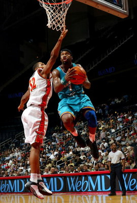 ATLANTA - NOVEMBER 3:  Baron Davis #1 of the New Orleans Hornets beats Boris Diaw #32 of the Atlanta Hawks during the game November 3, 2003  at Phillips Arena in Atlanta, Georgia. NOTE TO USER: User expressly acknowledges and agrees that, by downloading a