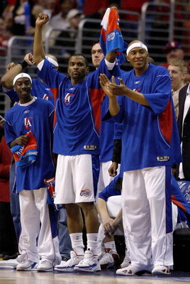 LOS ANGELES - APRIL 24:  (L-R)  Cuttino Mobley #5 and James Singleton #15 of the Los Angeles Clippers cheer from the bench as the Clippers lead the Denver Nuggets in game two of the Western Conference Quarterfinals during the 2006 NBA Playoffs on April 24