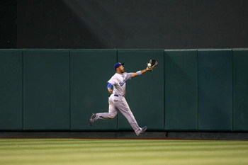 ANAHEIM, CA - JUNE 21:  Center fielder Matt Kemp #27 of the Los Angeles Dodgers  chases a fly ball against the Los Angeles Angels of Anaheim on June 21, 2009 at Angel Stadium in Anaheim, California.   The Dodgers won 5-3. (Photo by Stephen Dunn/Getty Imag