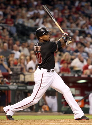 PHOENIX - JUNE 27:  Justin Upton #10 of the Arizona Diamondbacks bats against the Los Angeles Angels of Anaheim during the major league baseball game at Chase Field on June 27, 2009 in Phoenix, Arizona. The Angels defeated the Diamondbacks 2-1.  (Photo by