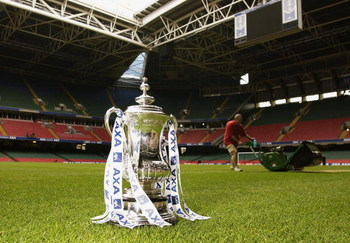 CARDIFF - MAY 3:  The FA Cup trophy sits proudly on the pitch as a groundsman makes final preparations for the final of the FA Cup during the AXA FA Cup Preview held at The Millennium Stadium in Cardiff, Wales on May 3, 2002. (Photo by: Stu Forster/Getty