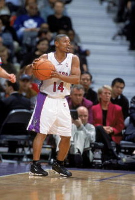 31 Oct 2000:  Muggsy Bogues #14 of the Toronto Raptors moves with the ball during the game against the Detroit Pistons at the Air Canada Center in Toronto, Canada. The Pistons defeated the Raptors 104-95. NOTE TO USER: It is expressly understood that the