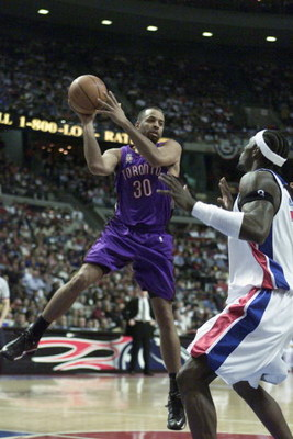 AUBURN HILLS - APRIL 21:  Dell Curry #30 of the Toronto Raptors passes over Ben Wallace #3 of the Detroit Pistons during game 1 of the Eastern Conference Quarterfinals during the 2002 NBA Playoffs at the Palace in Auburn Hills in Auburn Hills, Michigan on