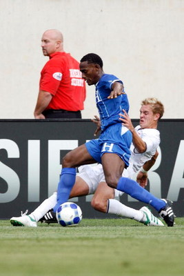CHICAGO - JULY 23:  Stuart Holden #10 of the USA slide tackles Carlos Palacios #14 of Honduras during their CONCACAF Cup Semifinal match at Soldier Field on July 23, 2009 in Chicago, Illinois.  (Photo by Brian Kersey/Getty Images)