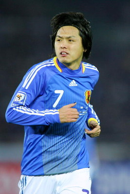 YOKOHAMA, JAPAN - FEBRUARY 11:  Yasuhito Endo of Japan in action during the 2010 FIFA World Cup Asian qualifying match between Japan and Australia at Nissan Stadium on February 11, 2009 in Yokohama, Japan. (Photo by Koji Watanabe/Getty Images)