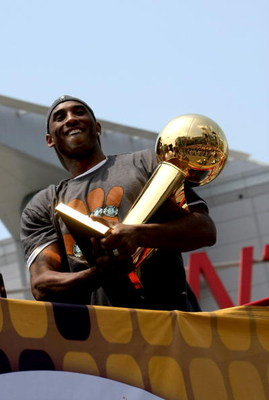 LOS ANGELES, CA - JUNE 17:  Kobe Bryant #24 holds the Larry O'Brien trophy as he rides on the top of a double decker bus at the start of the Los Angeles Lakers NBA championship victory parade outside the Staples Center on June 17, 2009 in Los Angeles, Cal