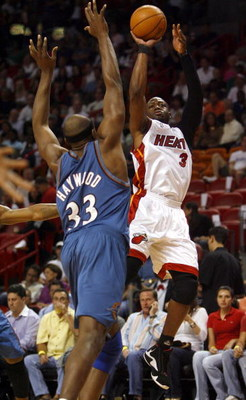MIAMI - APRIL 11:  Guard Dwyane Wade #3 of the Miami Heat jumps and shoots over Brendan Haywood #33 of the Washington Wizards on April 11, 2007 at the American Airlines Arena in Miami, Florida.  NOTE TO USER: User expressly acknowledges and agrees that, b