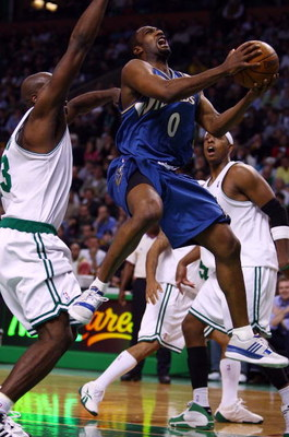 BOSTON - NOVEMBER 02:  Gilbert Arenas #0 of the Washington Wizards heads for the basket as Kendrick Perkins #43 of the Boston Celtics defends on November 2, 2007 at the TD Banknorth Garden in Boston, Massachusetts. The Celtics defeated the Wizards 103-83.